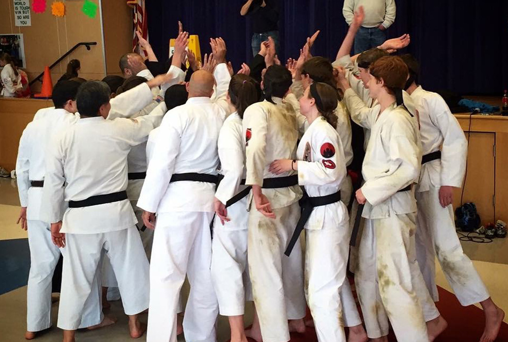 Quest Black Belt family celebrates